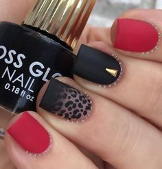 A fierce looking leopard nail art design. You can look at this design and definitely tell that it has a strong impact with its bold black and red colors slowly forming into leopard prints. The gold embellishment on top serves as a crown to glorify the elegant design.