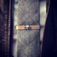 Scull and Crossbones tie bar & leather jacket. Ill