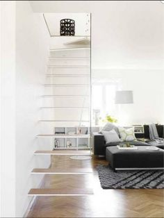 Floating stairs - Steel cantilevering from wall with thin timber treads