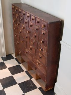 A useful bank of characterful haberdashery drawers with original labels and 3 drawer sizes with pigeon holes along the base. Late 19th century