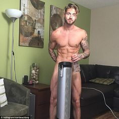 Alberta male model Travis DesLaurier posts topless video of him weightlifting a CAT  | Daily Mail Online