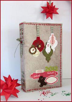 Couverture en feutrine, points de broderie et quelques perles ... Souvenirs d'un marché de Noël.