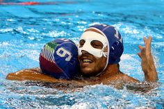 Christian Presciutti Photos - Matteo Aicardi #11 of Italy celebrates with Christian Presciutti #9 against Team Montenegro during their Men's Water Polo Bronze medal match on Day 15 of the Rio 2016 Olympic Games at the Olympic Aquatics Stadium on August 20, 2016 in Rio de Janeiro, Brazil. - Water Polo - Olympics: Day 15