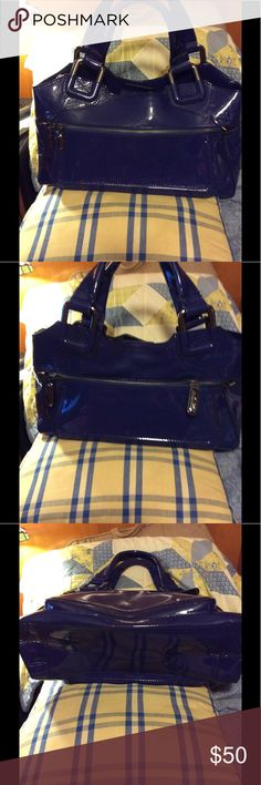 EUC Deep Blue patent leather tote This patent Tote is. By MAXX New York. It is a stiffer patent leather and a bit heavy. This inside is made of a marine blue satin. Clean and no marks Maxx New York Bags Totes