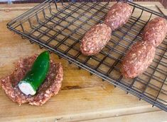 Smoked Armadillo Eggs.  Jalapeño peppers stuffed with cream cheese and cheddar then surrounded with sausage or hamburger meat.