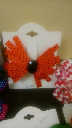 Orange and black polka dot $2.50