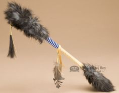 This is a very unique Cherokee Native American talking stick. In the Native American culture the talking stick was used to give each person in the circle a chance to speak with the respect of the othe