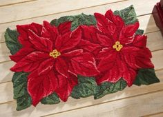 "Poinsettia Holiday Accent Rug By Collections Etc by Collections. $13.99. Hand-hooked acrylic rug features two impressive red poinsettias in all their holiday splendor. Vacuum, spot clean. Imported. 20"" x 30""."