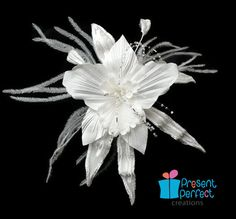 Handmade silk and velvet fantasy orchid fascinator, white orchid flower comb.  Available for purchase via Etsy.