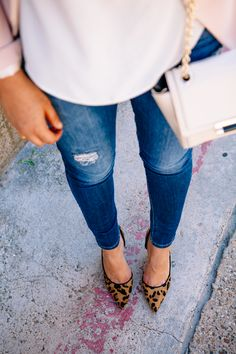 Bright blue wash jeggings White sweater ANIMAL PRINT FLATS + accessories to dress up outfit