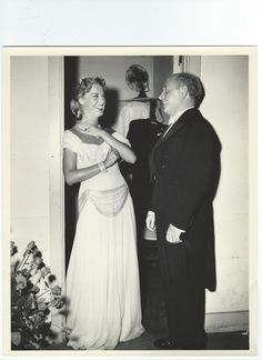 """Original, vintage photo of Jeanette MacDonald and Eugene Ormandy. Back of the photo states:TWO ARTISTS GET TOGETHER...Jeanette MacDonald is amused by something or other Eugene Ormandy is saying to her  before her concert at the Hollywood Bowl. Ormandy conducted the symphony orchestra for Miss MacDonald's singing which marked the MGM star's 2nd appearance at the Bowl."""" - ESCANO COLLECTION"""