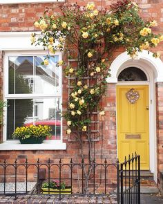 A brightly colored front door is the best way to add a little extra curb appeal to a brick home. Yellow Front Doors, Painted Front Doors, Best Front Door Colors, Front Door Paint Colors, Best Paint Colors, Paint Colors For Home, House Front Door, House Doors, Cottage Front Doors