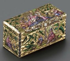 Louis XV jewel-set and enamelled snuff bo;  Ingot-shaped with Chinoiserie engravings.  The raised scrolling silver-gilt thumbpiece is stuffed with old-minen cut diamonds;  Paris, 1753.