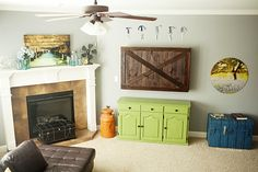 DIY Family Room Makeover   KristenDuke.com color & decor plus a barn door TV cover #home #living
