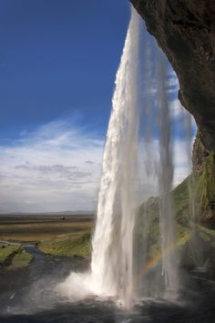 Seljalandsfoss, Iceland -   Ooh neat, I've been there! :D Walked behind the slippery rocks of these falls, but my images were nowhere near as lovely as this. It was a pretty cold, grey, rainy day when I visited this spot. Nice to see it looking happy.