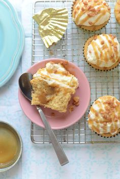 Butterscotch Cupcakes Supreme - Moist brown sugar cupcakes brushed with rum syrup, injected with homemade butterscotch sauce, Butterscotch Cupcakes Supreme - topped with whipped mascarpone frosting and drizzled with more butterscotch sauce and toffee bits @Rosie HW HW Alyea