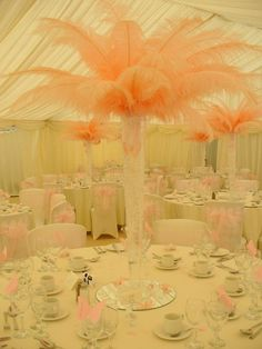 Fairytale Wedding:  Wedding centerpiece with ostrich feathers, butterflies,mirrors and lights @Rob Lowe