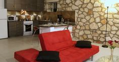http://keepwalkinganddiy.blogspot.gr/  #stone #wall #living #room #kitchen #puzzle #lamp #red #couch #studio #appartment