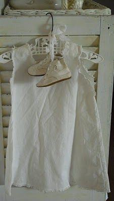 I love old baby shoes and dresses....I'm so doing this in my guest room !!