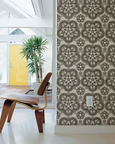 The wallpaper from Finland breaks up the clean white surface. Photo by John Clark. | @DwellonDesign