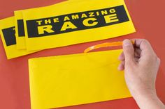 The Amazing Race tear-strip envelopes