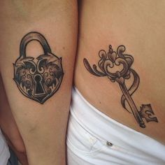 Very pretty and minimalist lock and key tattoo design. Drawn on separate hands, the lock and the key are recognized as a pair thanks to the matching heart designs.