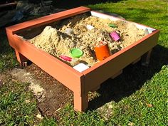 Converted raised bed. (can be used with soil instead of sand for gardening as well as a sandbox for kids)