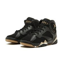 """BLACK/METALLIC GOLD-SAIL This special edition Air Jordan 7 Retro sneaker dropped in 2012 as part of the """"Golden Moments"""" Pack. The combination nubuck and leather upper is dressed in black with gold accents. Jordan Retro 7, Jordan 7, Black And Gold Jordans, Shoe Department, Retro Sneakers, Nike Shoes, Shoes Sport, Nike Air Jordans, Types Of Shoes"""