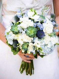 Bridesmaid bouquets will have touches of blue in the form of hydrangea and blue thistle