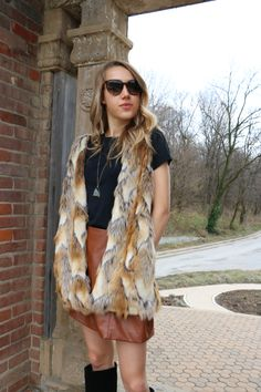 Transition to spring by layering winter and spring pieces together. Leather mini-skirt, fur vest, with boots // snapped by gracie