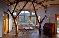 Reminiscent of SunRay Kelly, this architect/forester Roald Gunderson shapes small-diameter trees, then uses them as rafters and framing in the houses he designs.