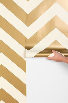 vinyl-coated, self-adhesive decorative wallpaper in a two-tone gold chevron from. vinyl-coated, self-adhesive decorative wallpaper in a two-tone gold chevron from Urban Outfitters. Gold Chevron Wallpaper, Chevron Walls, Herringbone Wallpaper, Metallic Wallpaper, Home Decor Inspiration, Design Inspiration, Decor Ideas, Urban Outfitters, Home Decoracion