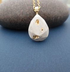 Golden Cement Pendant / cement jewelry / cement trend / gifts for her / fashion jewelry/concrete jewelry / teardrop pendant by BlueSouth on Etsy https://www.etsy.com/listing/287668987/golden-cement-pendant-cement-jewelry