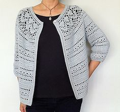 Featuring a floral lace yoke and a lacy stripe pattern, this feminine three-quarter sleeve cardigan is equally lovely dressed up or down. The cardigan is worked seamlessly in one piece starting with the lace yoke. The body and sleeves are crocheted from the yoke down, allowing you to adjust their lengths to suit. Pattern also includes button band instructions for both single and multiple buttonholes.