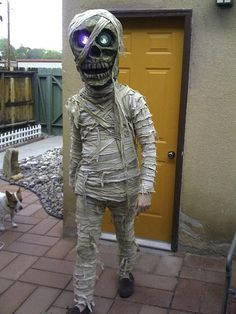 A Diy Mummy Costume With A Giant Skeleton Head More