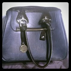 London Fog Handbag This bag rocks. Navy leather with black patent trim & handles. Side panels are brown ostrich. Perfect condition, very gently used only once or twice. London Fog Bags