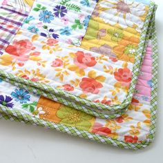 Vintage sheet quilt - love the curved corners and plaid binding - Chloë Owens: May 2012