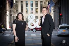 Craig and Diana   Engagement Photos in Chicago   Chicago Board of Trade  holding and sign