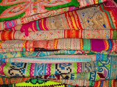 Endless colourful, patterned and stitched textiles.  Many pieces of textiles sold in the markets  of Chang Mai are pieces of traditional-style tribal clothing. If you dig deep, you can be lucky enough to find little antique gems!