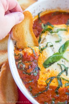 Baked Goat Cheese & Marinara Dip with Crostini - A festive holiday appetizer!