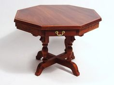 "Ralph Wakefield Table - A LE rosewood octagonal table with four drawers and carved decoration on the apron by Ralph Wakefield. 2.5"" H, 3.5"" W. An usual form, skillfully executed."