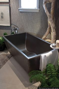 The Indulge concrete bath tub is the smaller version of the Double Wave. The feel of a solid, concrete tub, and the contoured bottom that cradles your body and makes this tub comfortable even without water. Optional, embedded heating coils for when you don't want to get out. To get all of this with room for two, see our magnificent Double Wave Tub. All products made in America from sustainable EarthCrete™ Concrete, the best concrete on earth. See tub fillers at sonomaforge.com.