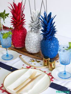Love this quirky Fourth of July centerpiece from @freutcake —glittered pineapples!!