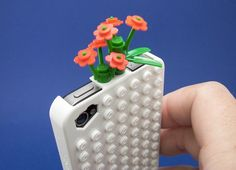 Lego iPhone case - my daughter would love it if i had this bc of her obsession with her little hello kitty lego land set and the fact that she hijacks my phone constantly!