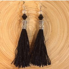Black tassle earrings These are black tassles with Tibetan silver. It has a black glass bead and a faceted clear glass bead. They hang 3 1/2 inches. Handmade by me NWOT. 925 Sterling silver ear wires Jewelry Earrings