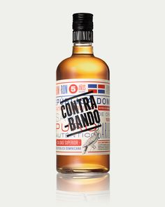 """Contrabando Rhum  Label design for Grupo Caballero's new rhum, by Tres Tipos Gráficos.    The goal was to emphasize the product's caribbean roots by stamping its name """"Contrabando"""" (meaning smuggling in spanish) forcefully over the traditional graphic imagery, as if local customs had busted an original foreign product."""