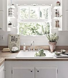Wide window over kitchen sink.