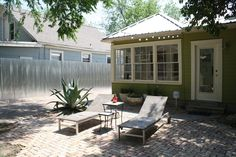 corrugated metal fence, cool patio with pavers.