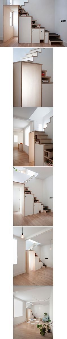 Plywood staircase by Buj+Colón Arquitectos integrates shelves and cupboards for a small flat  http://www.dezeen.com/2015/01/03/buj-colon-architects-plywood-trio-apartment-refurbish-madrid-staircase-storage/