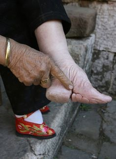 In many Asian countries, people have believe that small feet of women are one of the most important traits that men looks for.  (Of course this is not really going on as seriously as 50 years ago)  Here's a picture of an old woman who used to be a Geisha.